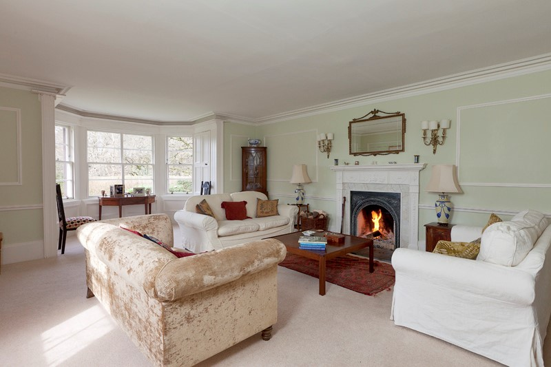 Light sitting room with open fire