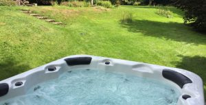 Big hot tub in garden of Scottish hen party house