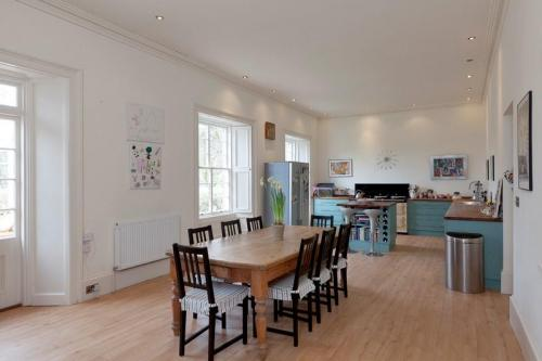 Enormous, fully equipped kitchen with table and chairs for 12