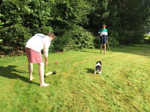 Family playing croquet in Perthshire garden